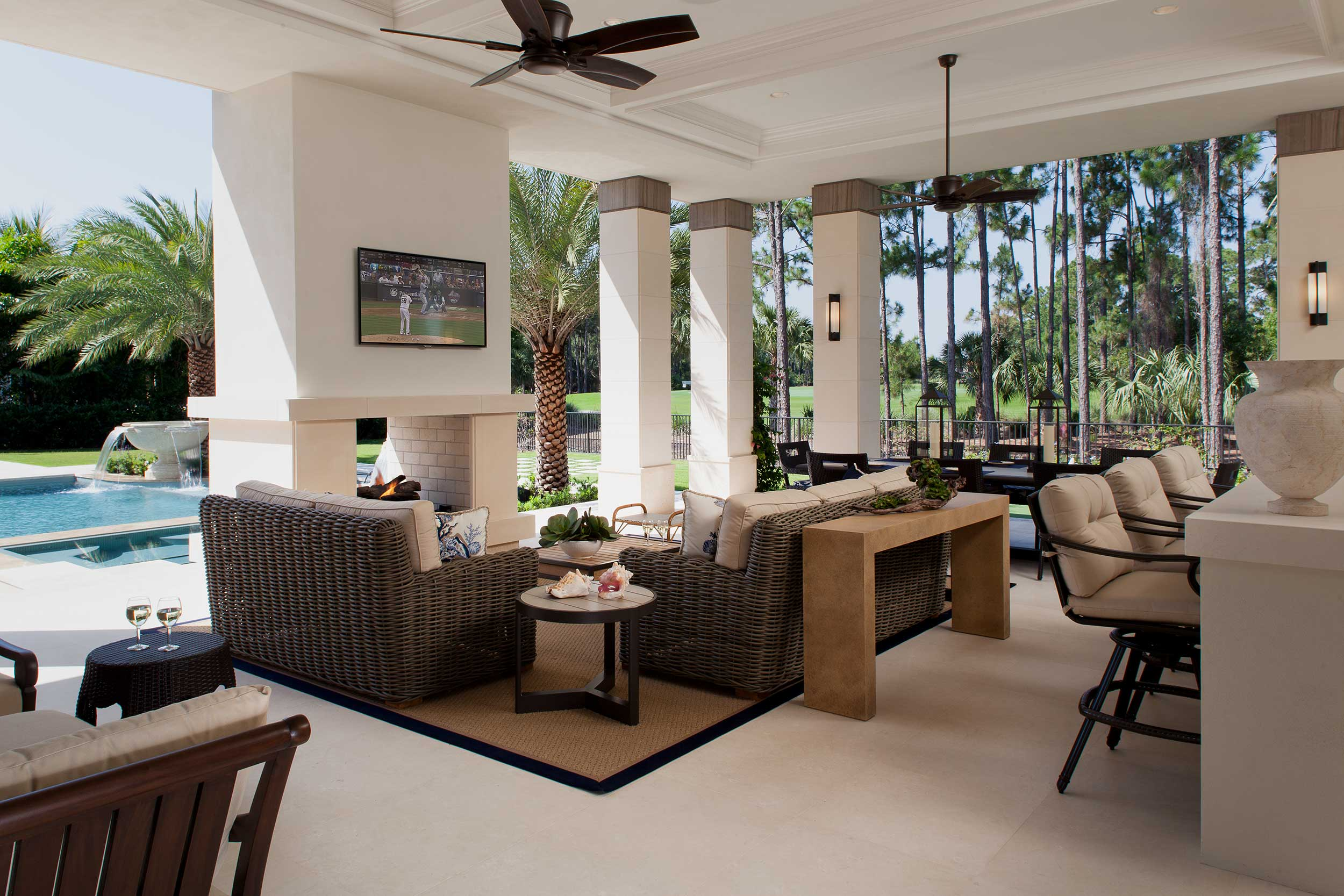 Outdoor living room with fireplace at Stuart, FL