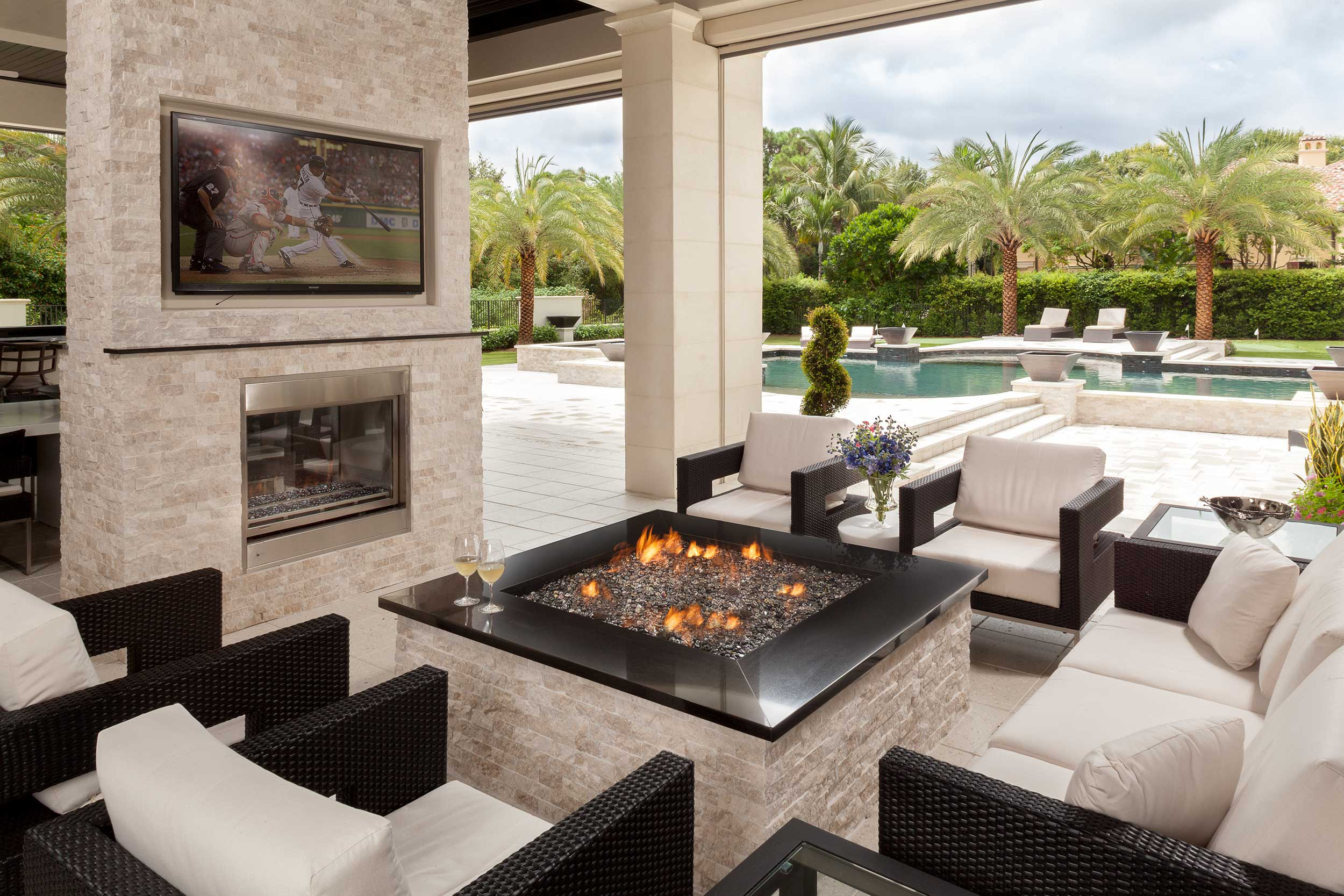 Dramatic outdoor living space with fire pit in Jupiter, FL