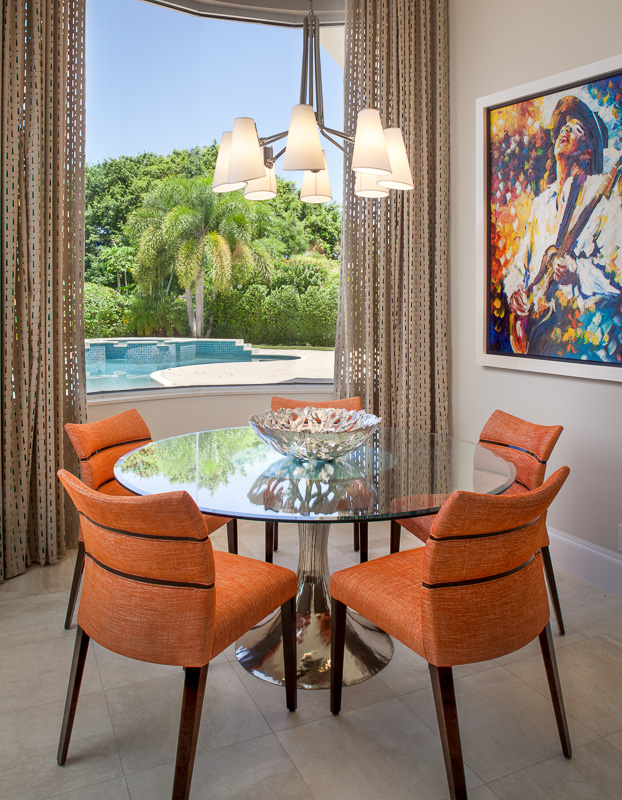 Pop of orange dining room at Admiral's Cove