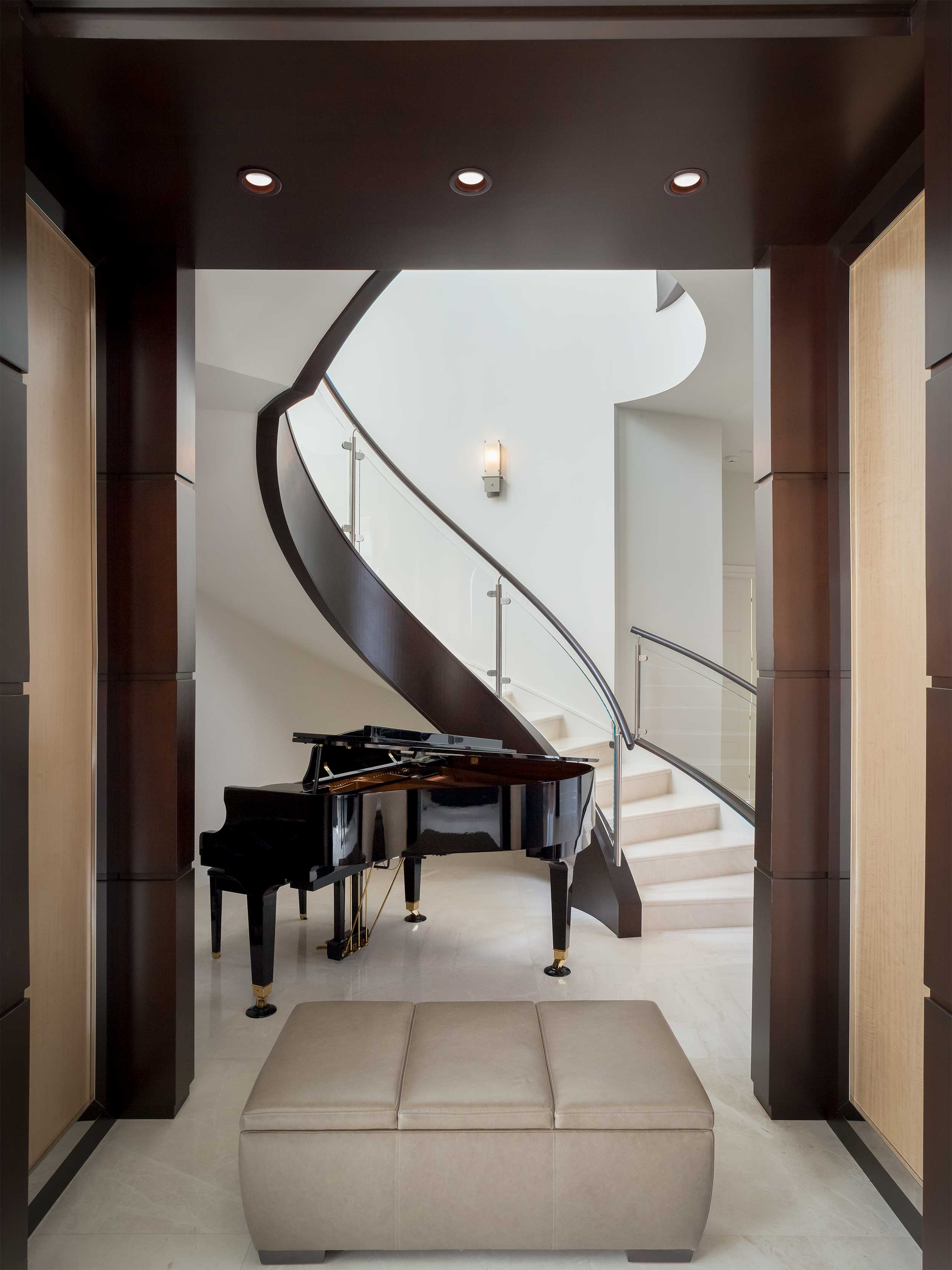 Piano and spiral staircase in Residential Interior Design Project in Jupiter, FL